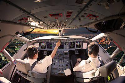 Pilots flying plane